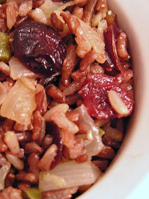 Harvest Rice Salad - uses slivered almonds, chicken broth, brown rice, wild rice, butter, onions, brown sugar, dried cranberries, green bell pepper, lemon zest, and salt & pepper