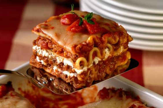 This basic, classic lasagna recipe is all you'll need for a delicious, hearty lasagna meal. It's the perfect layering of meaty sauce, noodles, and cheeses.
