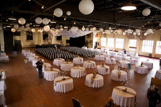 Ceremony And Reception In Same Room: White Round Tables, Round Tables And Paper Lanterns On