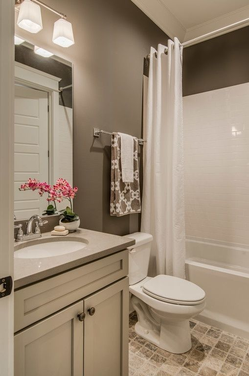 The Awesome Web Love the wall color Paint color is Sherwin WIlliams Portico SW Contemporary Full Bathroom with Flat panel cabinets limestone tile floors Slate