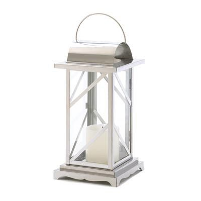 "**NEW ITEM**A classic candle lantern gains contemporary appeal from geometric styling and a gleaming polished finish. A sophisticated modernistic touch for any patio or garden. Use different elemental candle colors inside 4 of these to mark your quarters for outdoor rites. Great for camping & comes in handy at festivals and gatherings in the woods Weight 2.5 lbs. 15 1/2"" high with hanging loop on top. Stainless steel. Candle not included. Metal, Glass."