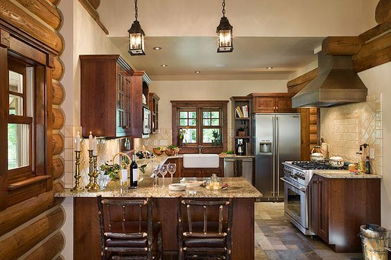 "Marylee loves the bronze hood, which she designed and had custom-built. The kitchen also features granite counters and tile backsplash. Bar chairs create a casual eating setup at the island. ""The chairs' style is very traditional, sturdy and multi-generational. If you've been to Yellowstone or Glacier national parks, that type of furniture is everywhere,"" Marylee observes."