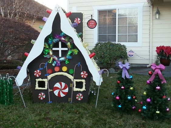 trees yard decorations and gingerbread houses on