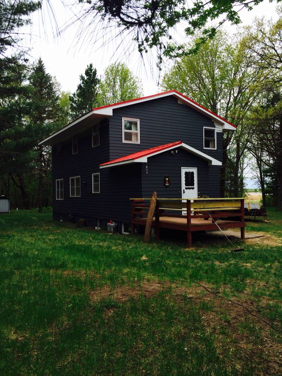 Best Dark Grey Exterior With Red Metal Roof And White Trim 400 x 300