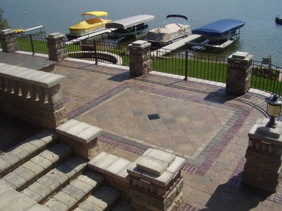 Stone patios create a gorgeous, high end look for lakeside homes. Hardscaping, exterior lighting, patio lighting, lake home renovation, Michiana