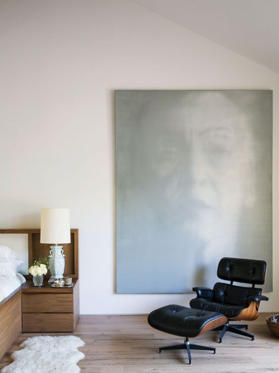 jenni kaynes bedroom with oversized art and an eames lounger | c magazine via coco kelley: