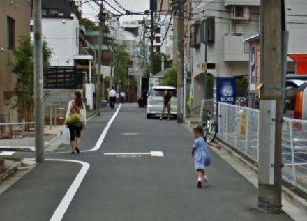 Japanese girl running from camera