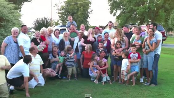 They thought they were just posing for a family photo. What they got instead was, not one but, two BIG surprises!