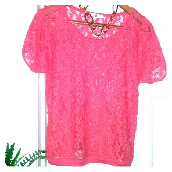 Flirty feminine lace top A super cute short sleeve top in sheer lace, by Iris Los Angeles. Perfect if you like to wear color it is a vibrant coral pink. Machine washable size junior large. Very good condition. Tops Blouses