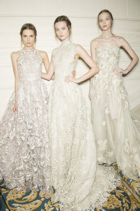 valentino models - middle part, two small side braids, low bun, loose whisps of hair around face  Valentino Couture Spring 2013