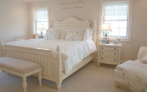 A romantic feminine Nordic French cottage style country bedroom with shabby chic style/cottage style furniture/white linens/upholstered bench/stenciled Emily Bronte quote above bed/neutral interiors/Hello Lovely Studio