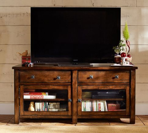 """BENCHWRIGHT TV STAND  $1,099.00  MEDIA STAND. The deeply weathered patina of 19th-century factory furniture was the model for our TV stand, creating a handsome backdrop for modern media equipment. Crafted from poplar, it's accented with grooves and saw marks for a look of salvaged lumber.  65"""" wide x 20"""" deep x 30"""" high; holds up to a 55"""" flat-screen TV"""