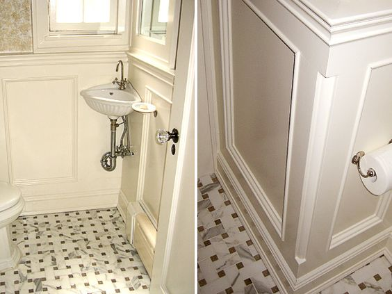 Small powder room with corner sink and vintage style tile floor. Small powder room with corner sink and vintage style tile floor
