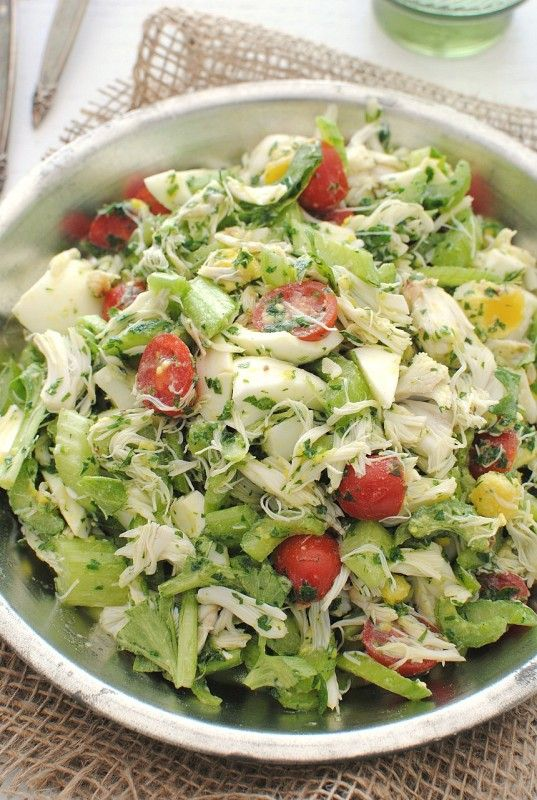 Crabmeat salad with celery, tomatoes, and hard boiled eggs ...