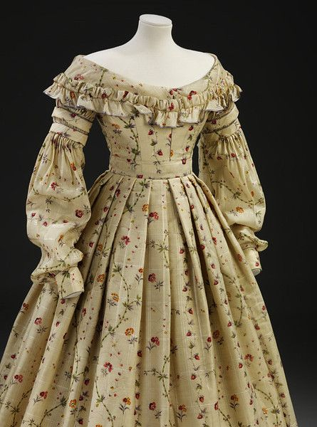 This 1830s day dress is made of challis printed with a realistic design of wild strawberries, bamboo, pinks and anemones. Technical improvements to the printing process and advances in dye chemistry meant that floral prints could be mass-produced at low prices, and the repeal of excise duty on printed textiles in 1831 helped to reduce costs.
