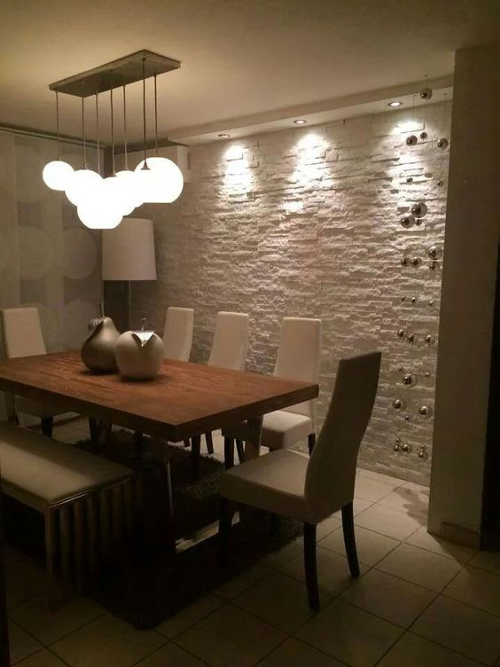 Iluminaci n sobre pared de piedra sal n living room - Decoracion de interiores modernos ...