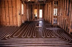 Radiant heat.  The most comfortable homes I have ever been in during cold weather were radiant heat homes.: