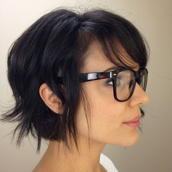 Choppy uneven layered hair with side-swept bangs