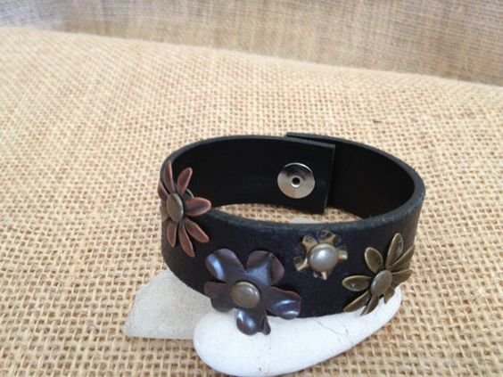 www.etsy.com/shop/journeyondesigns Leather cuff bracelet, handmade from recycled belts,  metal flower embellishments, black leather