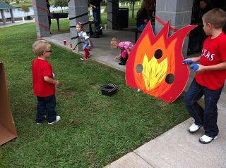 Activities: Fire Corn-hole game, bubbles, coloring, writing with chalk, playing the fire truck, and getting tattoos.: