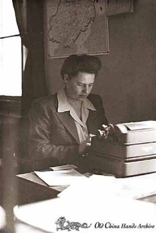 Ludmilla Luvdorski at work, Tientsin,China, 1946. Luvdorski was a Russian secretary who worked in the Civil Affairs Office, typing memorandums that magically got things done such as automobiles returned from Japanese military to civilian owners, schools opened, and the repatriation of refugees. Harold Giedt Photographs. Faces of Tientsin.