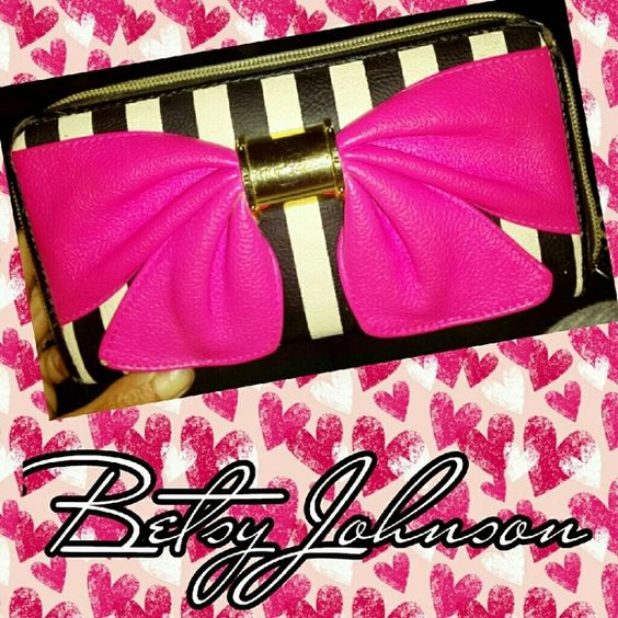 Betsy Johnson wallet Previously loved, slightly worn corners and one small spot missing on bow. Price is firm, I'd rather keep than take any less. Betsey Johnson Bags Wallets