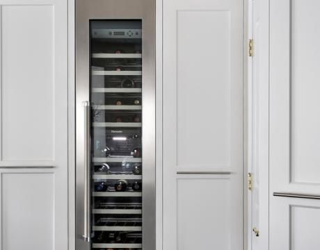 Break Up A Large Pantry Wall With A Tall Column For Wine
