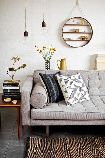 Living Room: Mixed graphic prints, grey tones and hints of yellow. Simple and stylish.  #interiordesign #colourschemes
