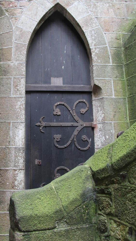 I wonder where this door leads to? Abbaye Mont St Michel France  photo by jadoretotravel
