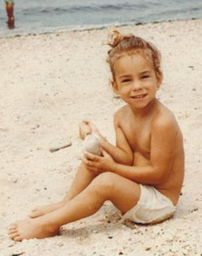 Mariah Carey    no top at the beach.. hmmmm   that*s how she started..funny