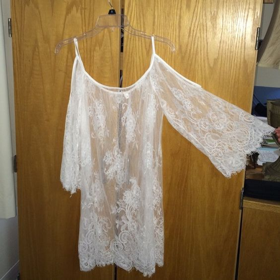 Boho lace see-through dress! Looks great over body con dresses! Never worn. Bought local so doesn't have brand! Dresses