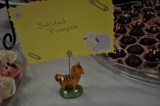 Got the animals at party city to hold the cards I made to display what food we had for the baby safari shower!