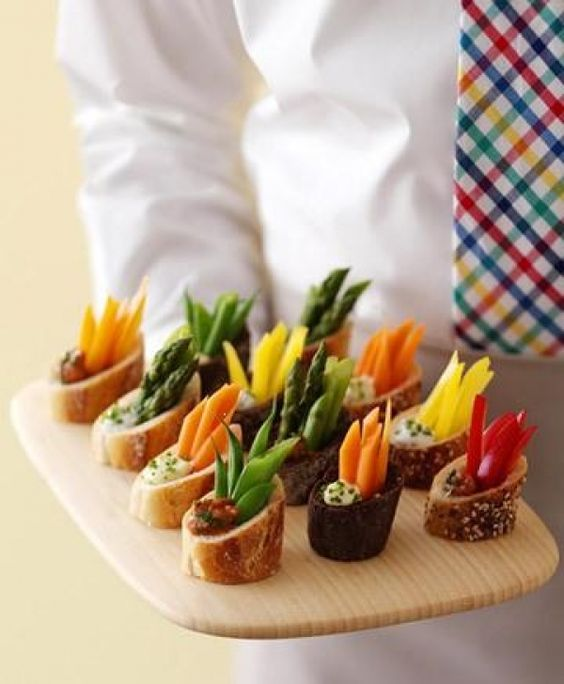 """Veggie appetizers    So easy, convenient and takes about 5 min to prepare. The best thing about this recipe that you can try any filling in these little bread appetizers. So great, less mess, when veggies are gone just """"eat the bread""""!!"""