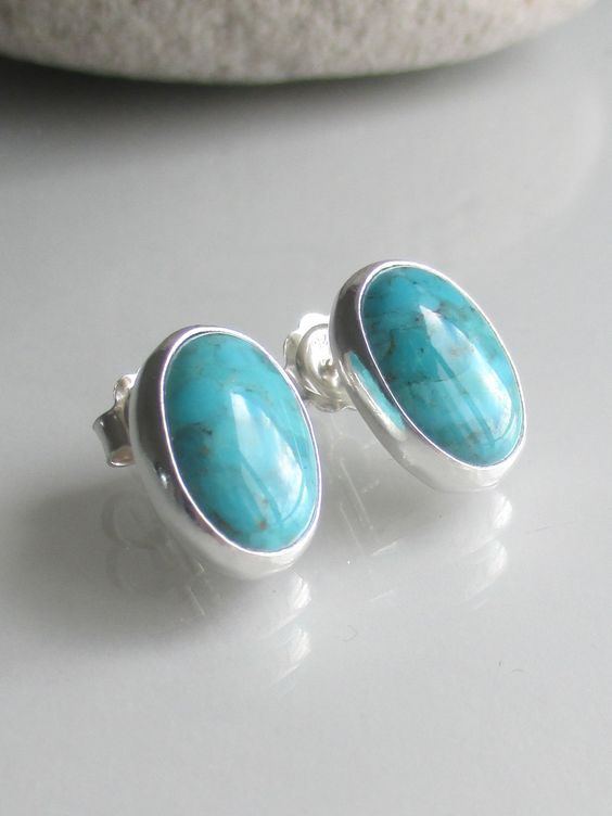 Turquoise stud earrings. 14 x 10mm oval cabochon gems.  Item: BC.