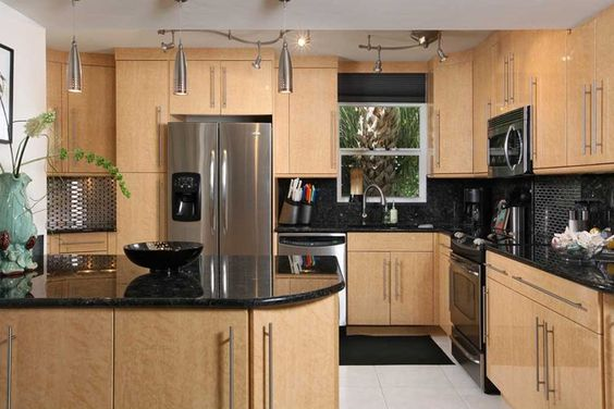 Contemporary kitchen black countertops pendants for Anchorage kitchen cabinets