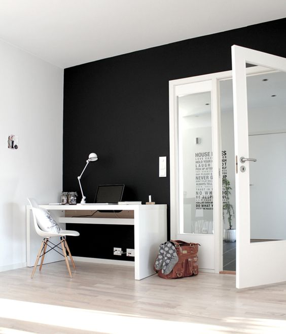 Dark accent wall. Not usually a fan of dark walls, but the relief for the white here is stunning. Photo only, via bloodandchampagne.com