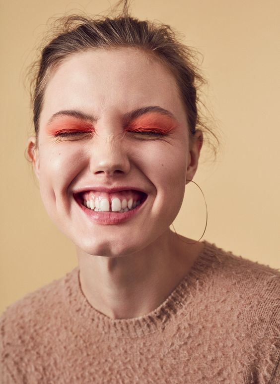 Leave the safety of browns and grays for just a second. Bright, bold peachy-pink shadow is as energizing as a Malibu sunrise.