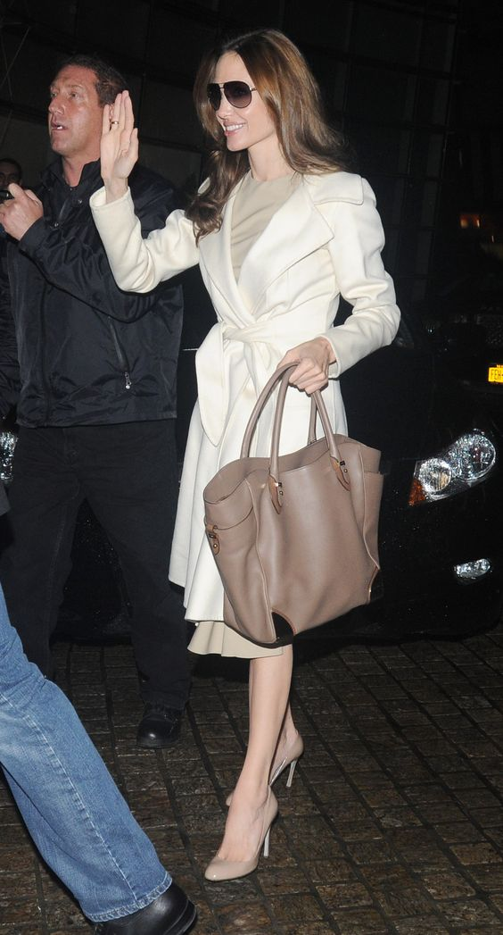 We love Angelina's take on classic creamy tones — the pumps, the bag, the coat, and the sheath all speak to understated sophistication.