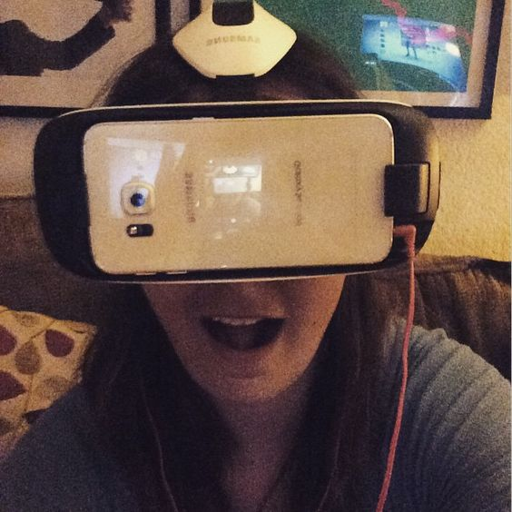 """An awesome Virtual Reality pic! The future is awesome! Watching Netflix on the Samsung Gear VR--currently I'm in a virtual home theater somewhere in the mountains. Still able to watch my show while my husband plays """"Destiny.""""  #gearvr #oculusrift samsunggalaxy #VR #oculus #virtualreality by caitlinthespy check us out: http://bit.ly/1KyLetq"""