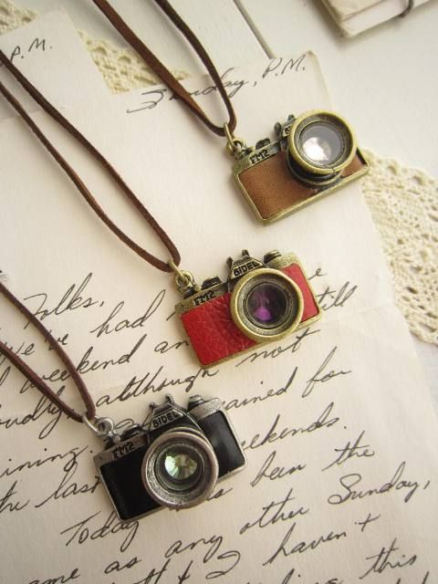 camera necklaces!!!I actualy repined this hopeing Hannah would see them because they are so cute and remind me of her=)