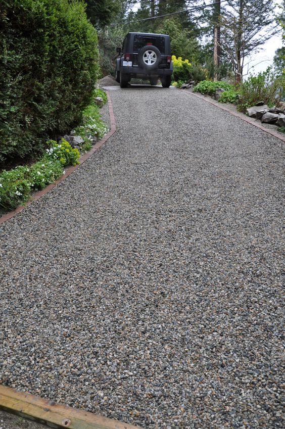 Landscaping Pebbles Sunshine Coast : Core gravel steep slope driveway install sunshine coast