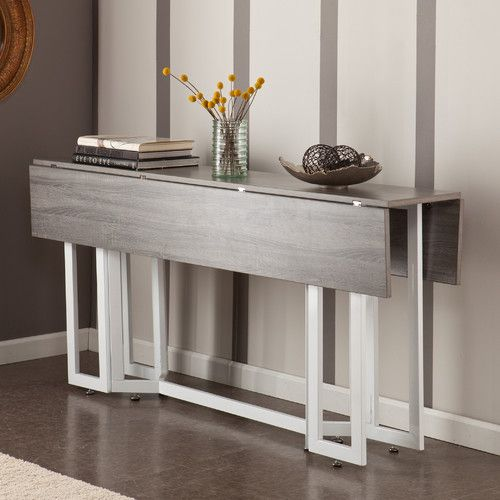 A modern drop leaf expandable console table that converts into a