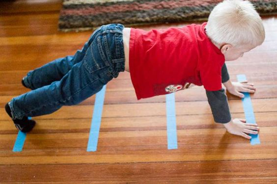 In the Montessori classroom, children Walk on the Line to help them control their bodies, to develop balance and perfect equilibrium, and to strengthen the mind's control of its body's movements. Here are some more activities you can do with lines of tape on the floor at home.