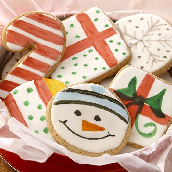 Don't just decorate, design! Mix food color and vanilla or lemon extract for holiday Flavor Paints and unique decorative cookies.