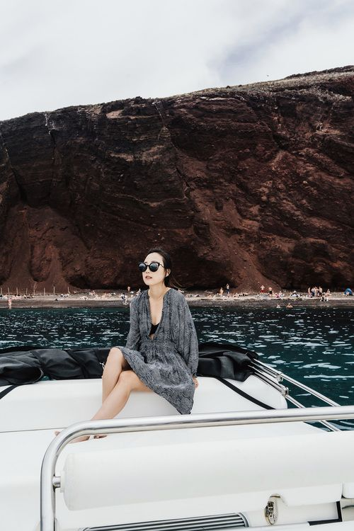 Apiece Apart Dress, Her The Label Swimsuit, Fendi Sunglasses in front of Red Beach