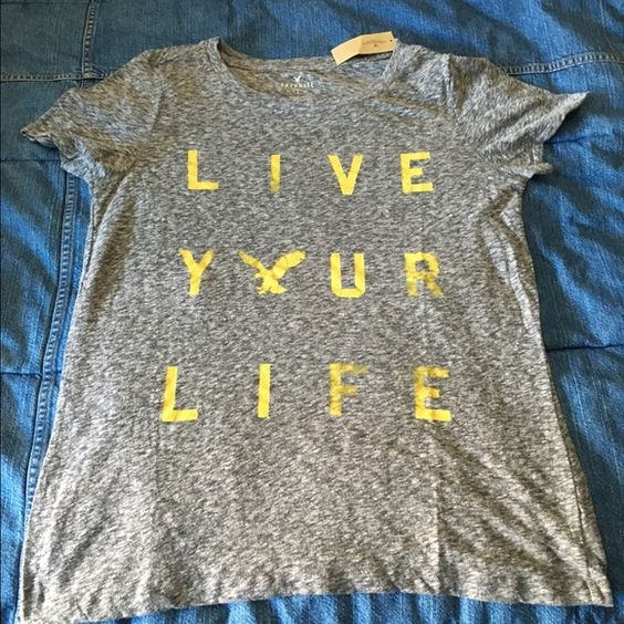 AE GRAPHIC LIVE YOUR LIFE Gray Tee Shirt Brand new AE Live Your Life Tee Shirt. I am Re~Poshing :(  I absolutely love this shirt but it's a little tight..... American Eagle Outfitters Tops Tees - Short Sleeve