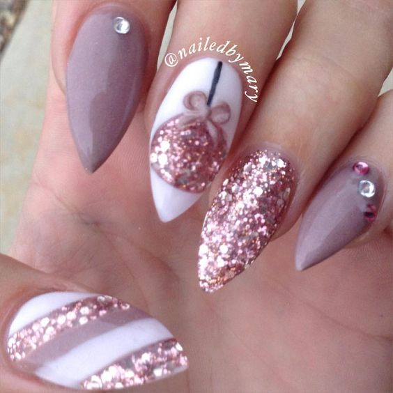 I like the thumb pattern for a feature nail instead. Nude pink for the rest with the feature nail white striped with gold glitter as well