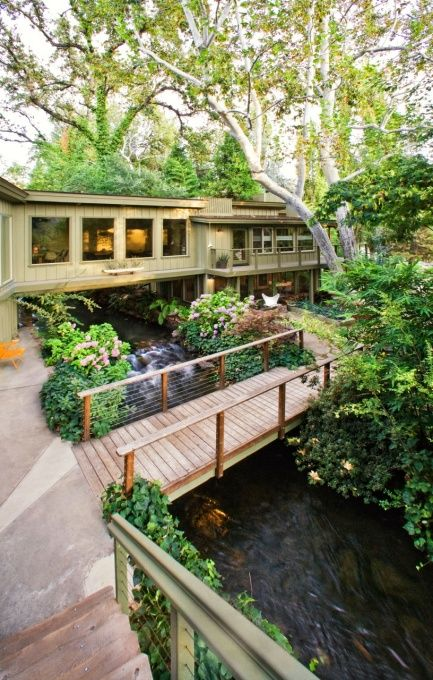 Home built over a stream.  I think this is as close as possible to living in paradise.