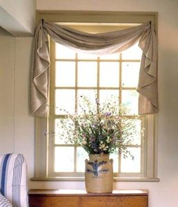 Use tie backs to hang window scarf - like this idea for kitchen sink window.
