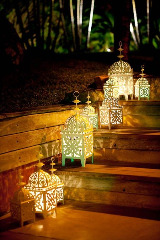 A cute set of simple Moroccan lanterns used outdoors in a garden.: